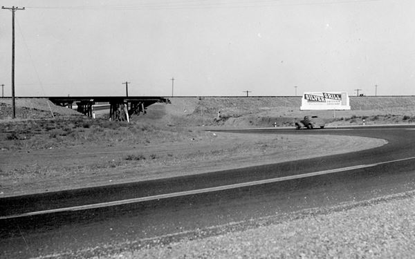 car entering underpass on US66 black and white 1940s photo