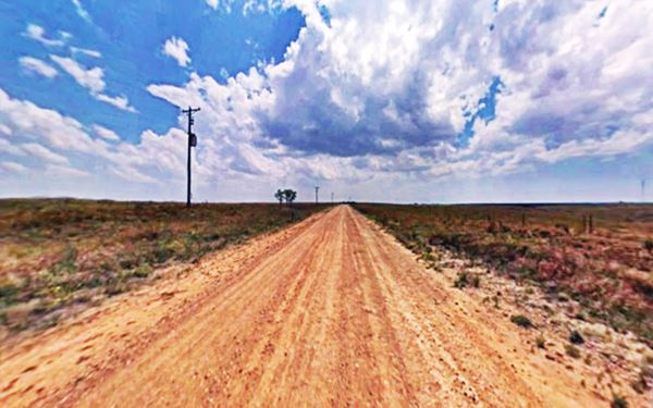 US 66 Jericho Gap dirt road in the open range