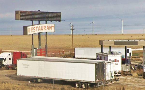 trucks by ruinous Restaiurant neon sign