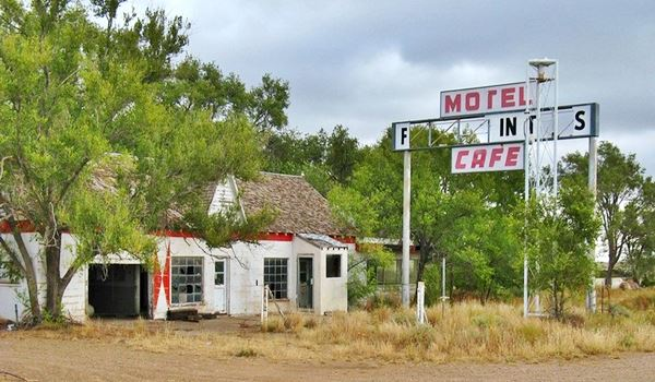 Old cafe and gas station in ruins
