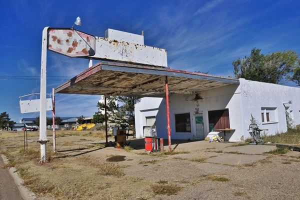 canopy, whitewashed neon sign, office and garage of old gas station