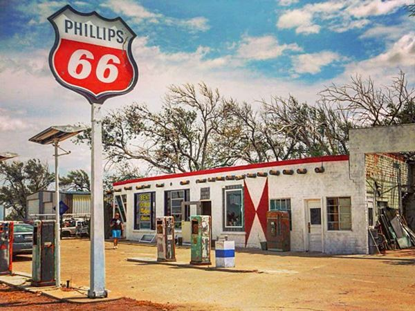 classic Pillips 66 and sign and old cafe